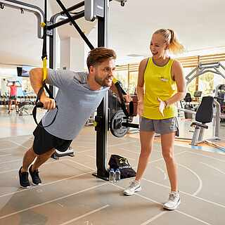 Fitness entertainer with a customer at a personal training